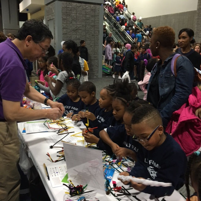 BPS Council member Bob Nakamoto, University of Virginia, helps elementary school students with their neuron models.