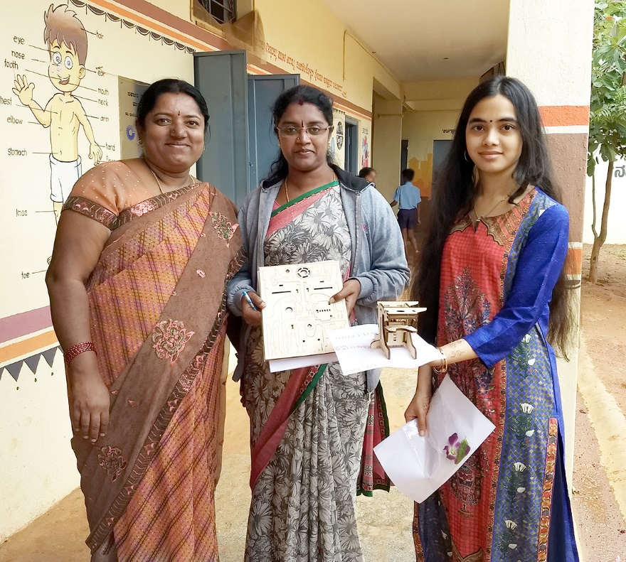 Umika (right) with government teachers in Bangalore, India at a BPS-sponsored light microscopy outreach session in Summer 2018.