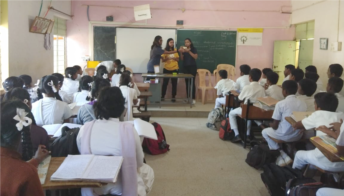 Teachers in a government school in Bangalore, India leading a BPS-sponsored light microscopy outreach session in Fall 2018